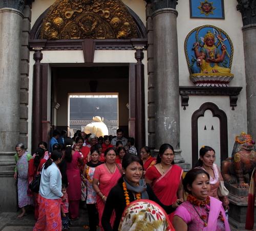 people leaving temple